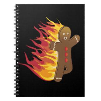 Gingerbreadman divertido en el fuego libros de apuntes