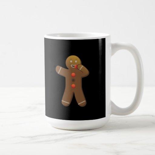 Gingerbreadman divertido que se come taza de café