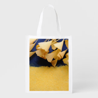 Ginkgo leaves on texture reusable grocery bag