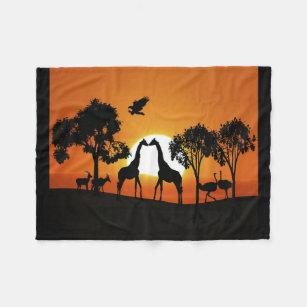 Giraffe at sunset fleece blanket