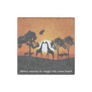 Giraffe at sunset stone magnet