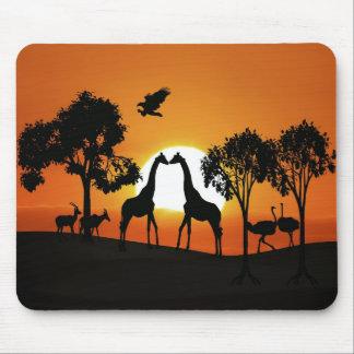 Giraffe at sunset mouse pad