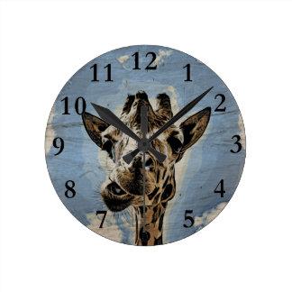 Giraffe chewing round clock