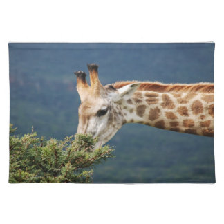 Giraffe eating some leaves cloth placemat