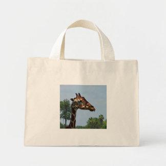 Giraffe head against blue sky photograph picture canvas bags