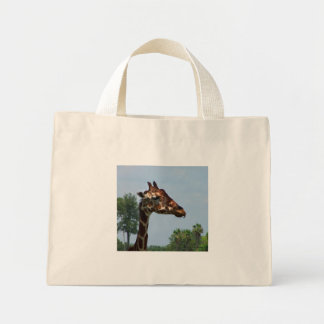 Giraffe head against blue sky photograph picture mini tote bag