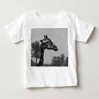 Giraffe head with plants and sky photograph baby T-Shirt