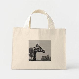 Giraffe head with plants and sky photograph canvas bag