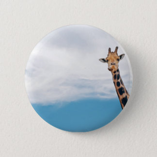 Giraffe neck and head against the clear blue sky button