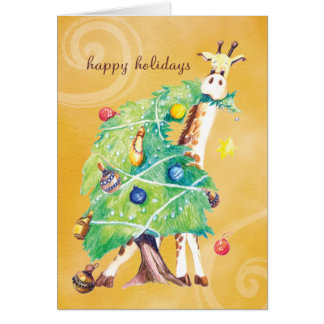 Giraffe nibbling on Christmas Tree Greeting Cards