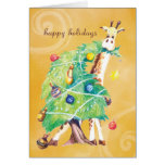 Giraffe nibbling on Christmas Tree Greeting Card