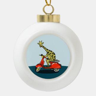 Giraffe riding a red scooter ceramic ball christmas ornament