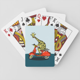 Giraffe riding a red scooter playing cards