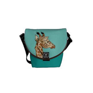 Giraffe with teal background messenger bag