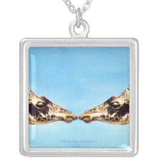 Giraffes touching noses silver plated necklace