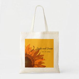 Girasol anaranjado en la bolsa de asas amarilla