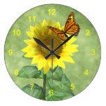 Girasol y mariposa relojes de pared