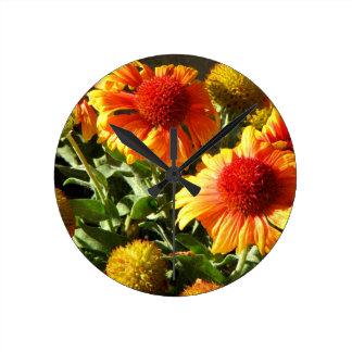 Girasoles anaranjados reloj de pared