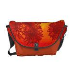 Girasoles descarados en naranja bolsa de mensajeria