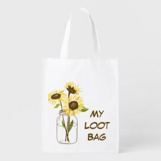 Girasoles en un bolso de compras del tarro de alba bolsa para la compra