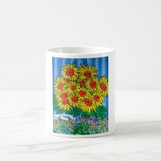 Girasoles soleados de la taza