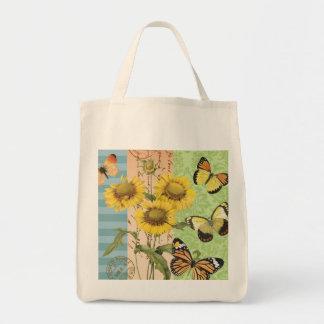 Girasoles y la bolsa de asas de moda de las maripo