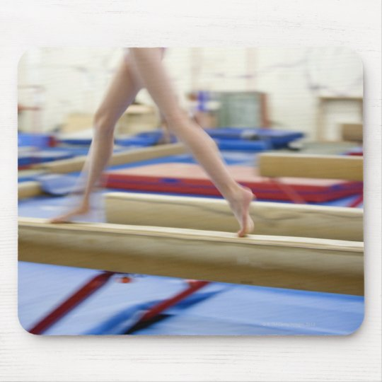 Girl (16-17) running on balance beam, low mouse pad