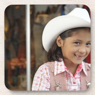 Girl (8-10) wearing stetson, smiling coaster