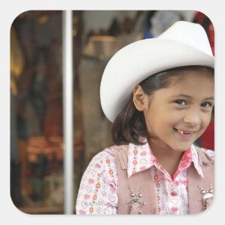 Girl (8-10) wearing stetson, smiling sticker