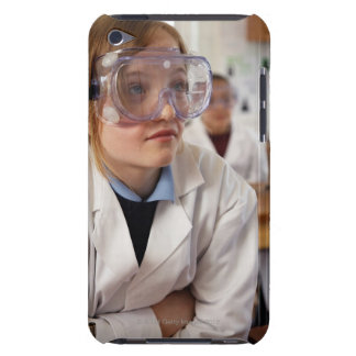 Girl (9-12) wearing protective goggles in barely there iPod covers