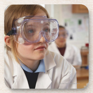 Girl (9-12) wearing protective goggles in beverage coaster