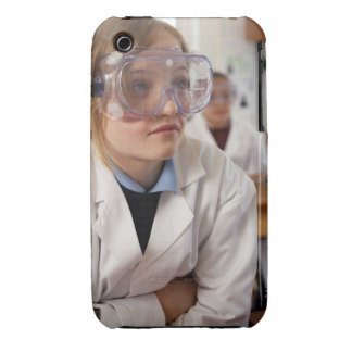 Girl (9-12) wearing protective goggles in iPhone 3 cover