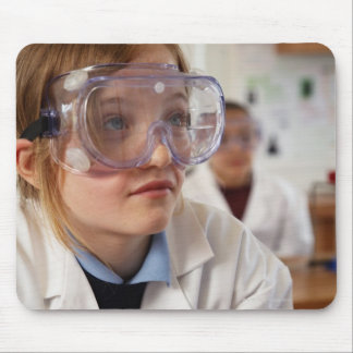 Girl (9-12) wearing protective goggles in mouse pad