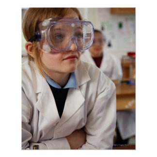 Girl (9-12) wearing protective goggles in poster