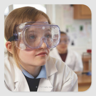 Girl (9-12) wearing protective goggles in stickers