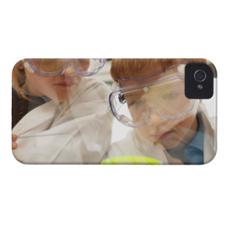 Girl and boy (11-13) looking at petri dish, view iPhone 4 cover