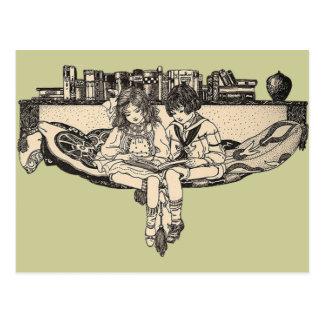 Girl and Boy Reading Postcard