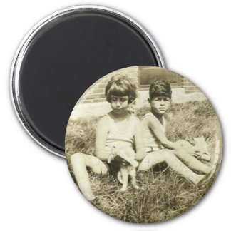 Girl and boy with cats on grass magnet