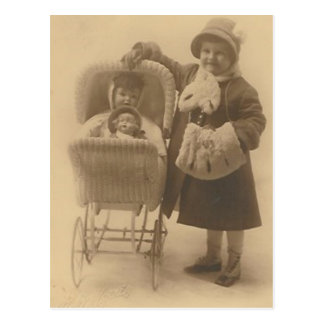 girl and her doll in carriage post card