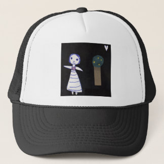 Girl and tree trucker hat