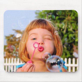 Girl Blowing Bubbles Mouse Pads