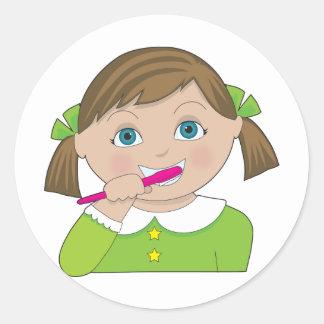 Girl Brushing Teeth Classic Round Sticker