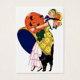 Girl carrying pumpkin business card
