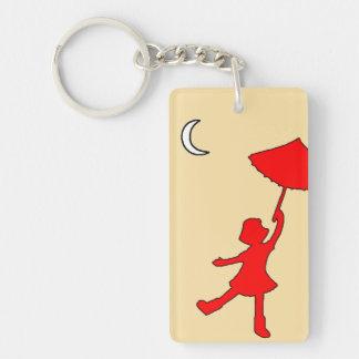 Girl dancing with her umbrella keychain
