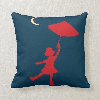 Girl dancing with her umbrella pillow