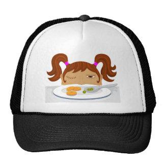 Girl deciding if she should eat her vegetables hat