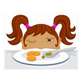 Girl deciding if she should eat her vegetables postcard