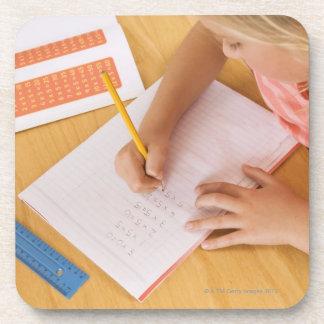 Girl doing homework drink coaster