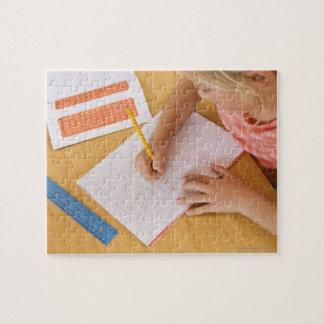 Girl doing homework jigsaw puzzle