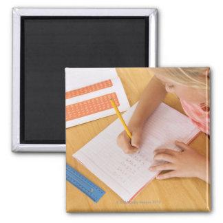 Girl doing homework magnets